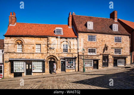 2 July 2019: Lincoln, Lincolnshire, UK - Jew's House and Jews' Court on Steep Hill, Lincoln. These buildings contain stonework from the 12th century. - Stock Photo