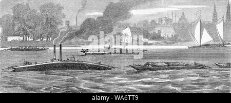 Fluvial traffic on the Elbe river near Dresden: a rescue tugboat tugging an ewer and a steamboat with sidewheels - Stock Photo