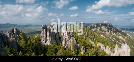 aerial view of ural nature. drone flying over the steep stony slope with coniferous and deciduous mixed forest at the foot of mountain. natiounal park - Stock Photo