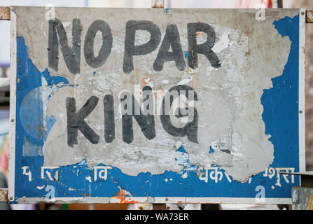 Vrindavan, India - February 22, 2018 - No Parking sign that looks more like  No Par King - Stock Photo