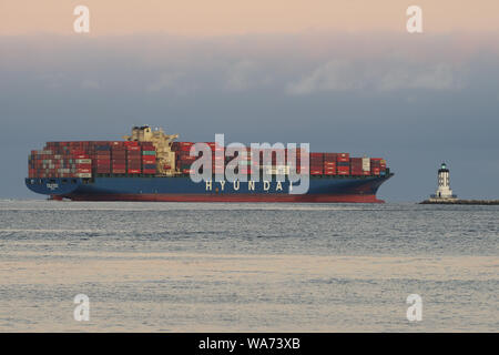 Image of Hyundai Brave container ship shown departing the Port of Los Angeles. - Stock Photo