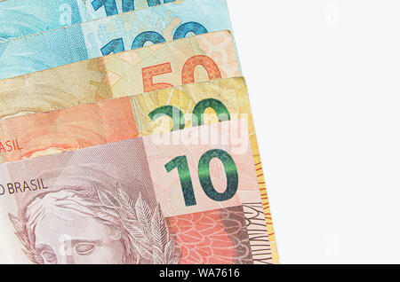 Brazilian real banknotes background isolated on white. 10, 20, 50, 100 reais brl. Brazilian money, real notes. Macro photo. - Stock Photo
