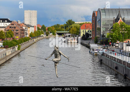 Bydgoszcz Poland - August 16, 2019: Sculpture placed on the Brda River on a rope stretched between the banks. - Stock Photo