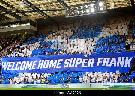 London, UK. 18 August 2019. Chelsea fans in the Shed end unveil a banner welcoming home Chelsea Head Coach Frank Lampard. Premier League match, Chelsea v Leicester City at Stamford Bridge in London on Sunday 18th August 2019.  this image may only be used for Editorial purposes. Editorial use only, license required for commercial use. No use in betting, games or a single club/league/player publications. Credit: Andrew Orchard sports photography/Alamy Live News - Stock Photo