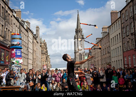 Royal Mile, Edinburgh, Scotland, UK. 18th Aug, 2019. Edinburgh Fringe street performer SYO! from Japan worked at a blistering pace to entertain the audience with a thrilling fire show on the third Sunday on the mid-High Circle pitch on the High Street. - Stock Photo