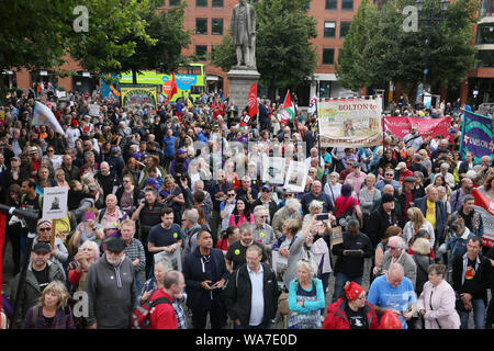 Manchester, UK. 18th August, 2019. Over a  thousand people are marching and attending a rally for democracy to coincide with the commemoration of the Peterloo Massacre, when on 16th August 1819 a crowd of 60,000 walked to the meeting point in St Peters Field when government forces charged into the crowd, killing 18 men, women and children and injuring hundreds.  200 years later and the city remembers. Suspended labour MP Chris Williamson was cheered and applauded as he spoke at the rally in Albert Square,  Manchester, UK. Credit: Barbara Cook/Alamy Live News - Stock Photo