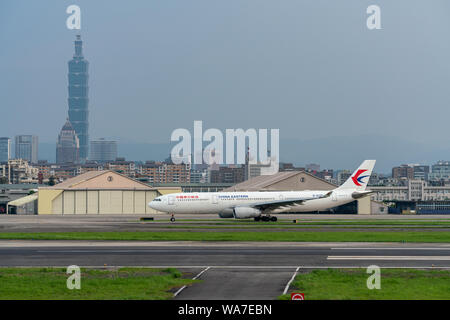 TAIPEI, TAIWAN - MAY 18, 2019: China Eastern Airlines Airbus A330-300 taxing at the Taipei Songshan Airport in Taipei, Taiwan.
