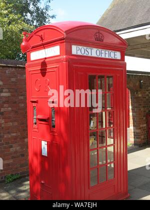 Photo of an iconic piece of British design, the old-fashioned and much-loved red telephone box that used to be on every street corner. - Stock Photo