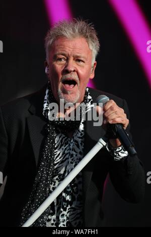 Henley-on-Thames, UK, 18th Aug 2019, Thousands of music fans gathered to enjoy a weekend of live 80's music from their musical legends at the Rewind South festival. Sunday featured a star-studded line-up. Paul Young  entertained the audience with his music. Credit: Uwe Deffner / Alamy Live News - Stock Photo
