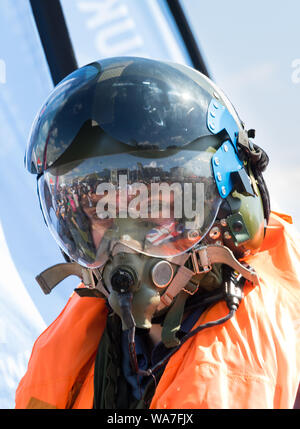 Eastbourne, UK. 18 Aug 2019. visitor to the Eastbourne Airshow gets to experience some of the equipment the crews wear.  Credit: Alan Fraser/Alamy Live News - Stock Photo