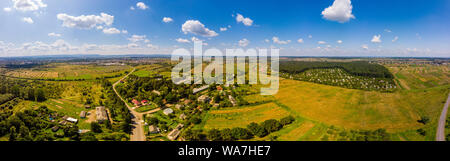 Panoramic landscape of countryside it the west of Ukraine. Aerial drone view of traditional Ukrainian village. - Stock Photo