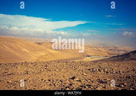 Mountain desert landscape. View of the valley from the mount. Desert in the early morning. The Judaean Desert. Landscape in Dead Sea region. Nature Is - Stock Photo
