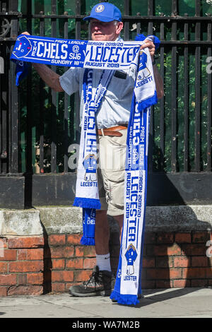 London, UK. 18 August 2019. A street vendor selling match day scarves outside Stamford Bridge for the English Premier League game between Chelsea Football Club and Leicester City. Credit: ZUMA Press, Inc./Alamy Live News - Stock Photo