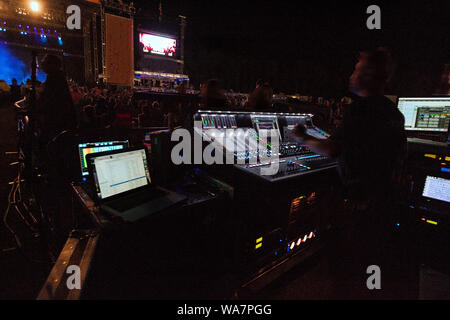 View of soundboard at outdoor music concert - Stock Photo