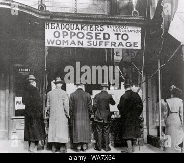 Passers-By Looking at Window Display at the Headquarters of National Association Opposed to Woman Suffrage. 1919 - Stock Photo