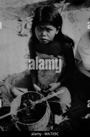 AJAXNETPHOTO. 1953-1957 (APPROX). INDO CHINA. VIETNAM. (IN-COUNTRY LOCATION UNKNOWN.) - YOUNG GIRL WITH BASKET AND TWO CAPTIVE BIRDS. PHOTO:JEAN CORRE/AJAXREF:RX7_191508_227 - Stock Photo