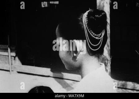AJAXNETPHOTO. 1953-1957 (APPROX). INDO CHINA. VIETNAM. (IN-COUNTRY LOCATION UNKNOWN.) -  YOUNG VIETNAMESE GIRL WITH TRADITIONAL HAIR DECORATION.PHOTO:JEAN CORRE/AJAXREF:RX7_191508_229 - Stock Photo