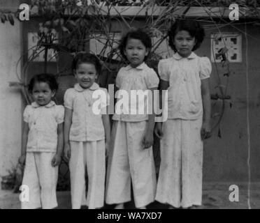 AJAXNETPHOTO. 1953-1957 (APPROX). INDO CHINA. VIETNAM. (IN-COUNTRY LOCATION UNKNOWN.) -  WELL DRESSED YOUNG VIETNAMESE GIRLS, POSSIBLY SIBLINGS.PHOTO:JEAN CORRE/AJAXREF:RX7_191508_284 - Stock Photo