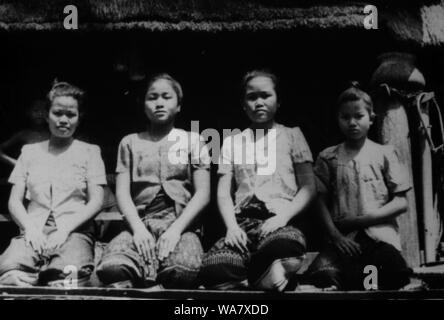 AJAXNETPHOTO. 1953-1957 (APPROX). INDO CHINA. VIETNAM. (IN-COUNTRY LOCATION UNKNOWN.) -  GROUP OF GIRLS POSE FOR THE CAMERA ON VERANDAH OF HOUSE ON STILTS.PHOTO:JEAN CORRE/AJAXREF:RX7_191508_226 - Stock Photo