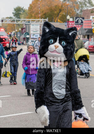 October 27, 2018 Coloma MI USA; a child dressed as a big black cat marches in a costume parade in this Halloween event - Stock Photo