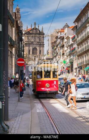 Portugal Oporto Porto Rua Clérigos Baroque Igreja dos Clérigos Clérigos Church 1750 old tram streetcar tourists cobblestones - Stock Photo