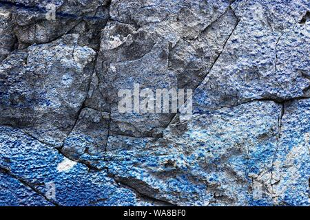 Close up view on detailed concrete walls with paint and cracks in high resolution - Stock Photo