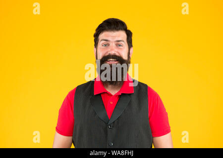 Happy face. Restaurant cafe staff wanted. Man bearded hipster with mustache wear vest shirt uniform yellow background. Shop staff concept. Salesman career. Hiring shop store worker. Hospitality staff. - Stock Photo