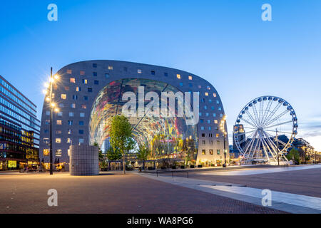 Rotterdam, Netherlands - May 13, 2019: Night view of Rotterdam city with Markthal in Netherlands. - Stock Photo