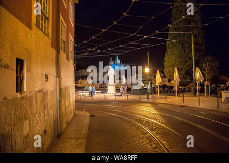 Scenic Alfama lookout with San Vicente (Saint Vincent) statue and Sao Vicente de Fora a church on the background - Stock Photo