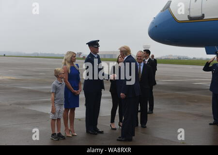 President of the United States Donald J. Trump disembarks Air Force One upon arrival at the Pennsylvania Air National Guard's 171st Air Refueling Wing in Coraopolis, Pa. Aug. 13, 2019. Greeting the president from the 171st is Col. Russell Adams, the Medical Group Commander. During his visit, Trump gave remarks at a local construction site in the area. (U.S. Air National Guard Photo by Tech. Sgt. Michael Fariss) - Stock Photo