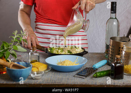 pouring sauce, white wine sauce, cook, jar, lobster pasta, alfredo sauce, sun dried, sun dried, pan, pasta water, spaghetti - Stock Photo