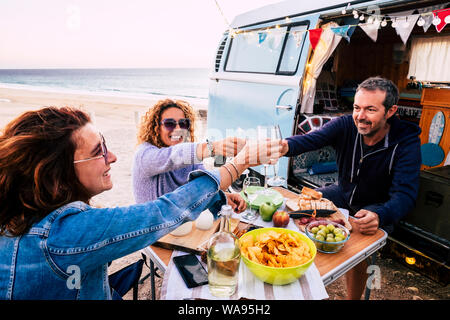 Happy people group of friends toasting and enjoying the travel vacation together - cheerful. womanandman with food in outdoor leisure activity - old v - Stock Photo