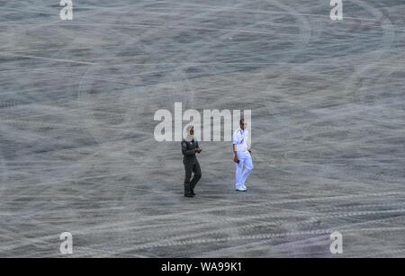 Langkawi, Malaysia - Mar 29, 2019. Royal Malaysian Air Force officer and pilot walking at Langkawi Airport (LGK). - Stock Photo