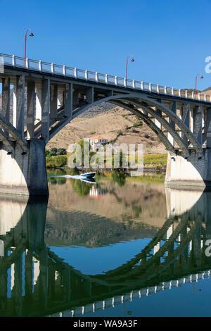 The bridge across the Douro and Agueda rivers at  Barca de Alva in the Douro International Natural Park, in the Tras-os-Montes e Alto Douro region of - Stock Photo