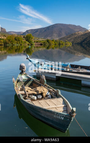 Traditional fishing boats on the Douro River at  Barca de Alva in the Douro International Natural Park, in the Tras-os-Montes e Alto Douro region of N - Stock Photo