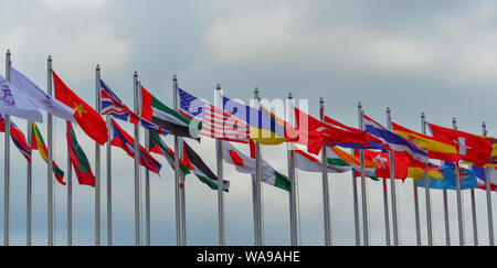 Langkawi, Malaysia - Mar 29, 2019. Flags of different countries in the park of Langkawi Airport (LGK). - Stock Photo