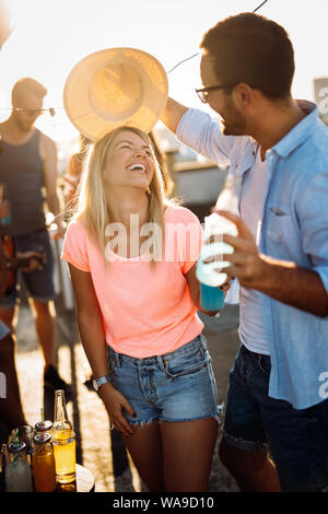 Happy young dancing couple having fun and enjoying party at summer - Stock Photo