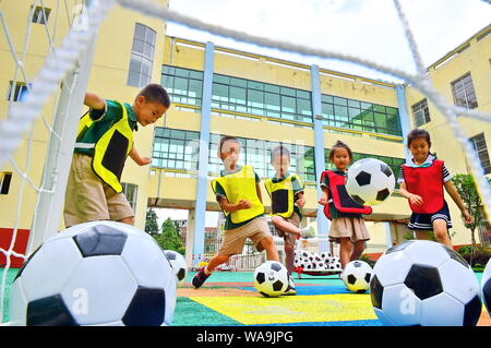 -FILE-Children play football at Central Kindergarten of Mazhou town, Huichang county, Ganzhou city, east China's Jiangxi province, 26 June 2019.     T - Stock Photo
