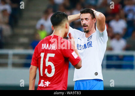 German football player Sandro Wagner, right, of Tianjin TEDA reacts as he competes against Guangzhou Evergrande Taobao in their 17th round match durin - Stock Photo