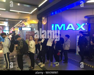 --FILE--Chinese filmgoers wait inside a cinema featuring IMAX before the midnight premiere of Disney and Marvel's 'Avengers: Endgame' in Beijing, Chin - Stock Photo