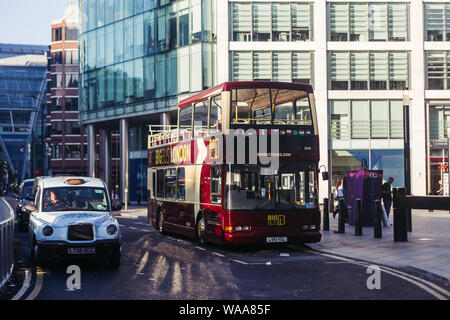 London / UK - July 18, 2019: cab and an open roof bus near Victoria Train Station in the centre of London. London is one of the most visited cities in - Stock Photo