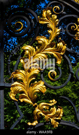 Gold ornamented fence at St Pancras Church in London - Stock Photo