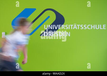 Dresden, Germany. 19th Aug, 2019. Pupils walk through the school building of the university school on the fringes of an opening event (long-term exposure). The public and free primary and secondary school is a joint project of the state capital Dresden and the TU Dresden. Credit: Sebastian Kahnert/dpa-Zentralbild/dpa/Alamy Live News - Stock Photo