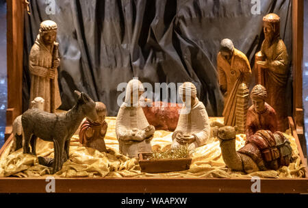 Small wooden Nativity scene, in a traditional English church. Christmas. Church of England. UK - Stock Photo