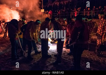 Lighting the torches at the 2019 Up Helly Aa festival on a snowy winter's night in Lerwick, Shetland - Stock Photo