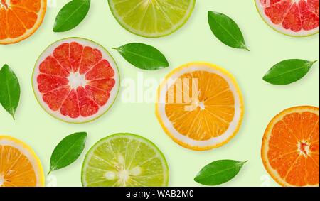Variety of whole and sliced citrus fruits , lemon, lime,grapefruit and orange - Stock Photo