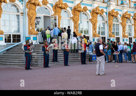 St Petersburg, Russia -- July 22, 2019.  Tourists line up to enter the Summer Palace; a marching band stands nearby. - Stock Photo