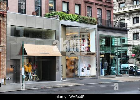 NEW YORK, USA - JULY 1, 2013: Stores along Madison Avenue in New York. Madison Avenue is one of the most recognized fashion shopping destination in th