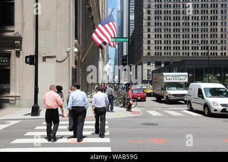 CHICAGO, USA - JUNE 27, 2013: People cross Jackson Boulevard in downtown Chicago. Chicago is the 3rd most populous US city with 2.7 million residents - Stock Photo