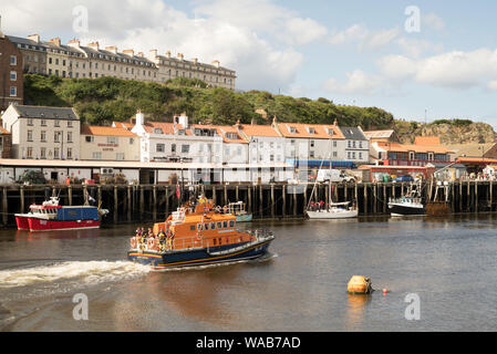 RNLI Trent class lifeboat RNLB George and Mary Webb leaving Whitby harbour, in Yorkshire, England, UK - Stock Photo